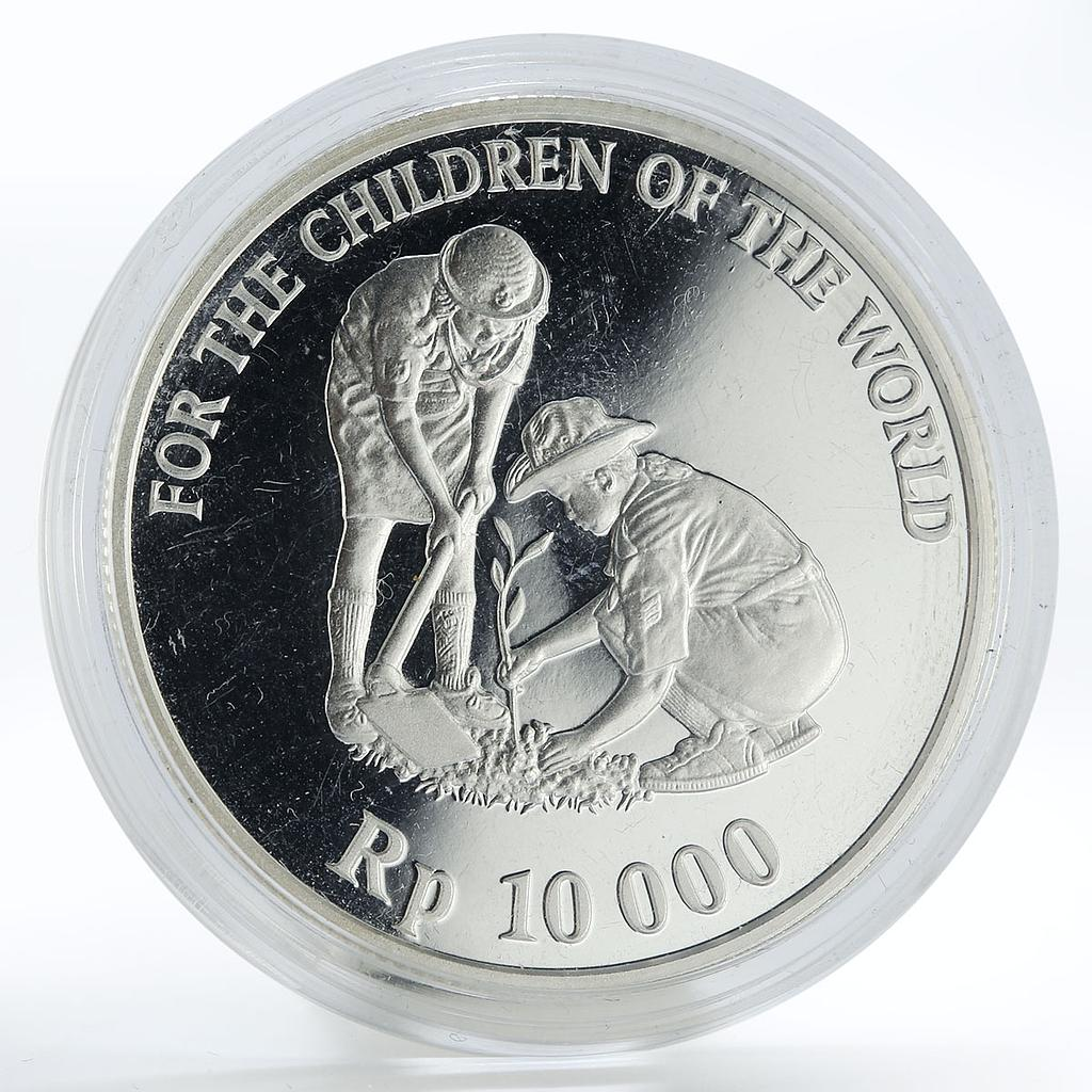 Indonesia 10000 rupiah UNICEF Girls scouts planting a tree silver coin 1999
